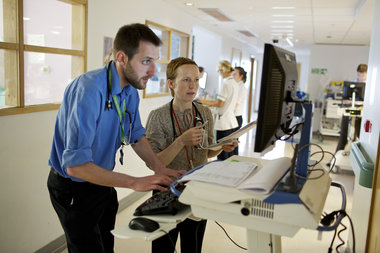 Clinicians looking at computer together