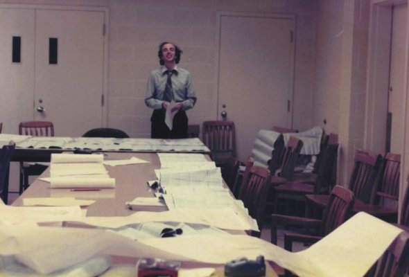 John moxham sorting through paper records 1970s listing